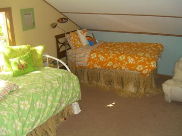 Surf Shack Sleeping Area (view is of two of three twin beds)