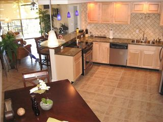 Kihei condo photo - Large open kitchen fully equipped with new granite top counters and appliances.
