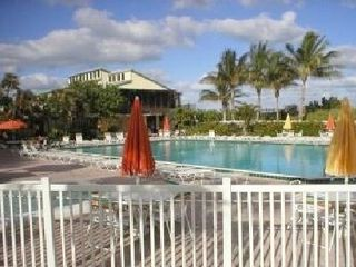 Hutchinson Island condo photo - Main Pool that has a Tiki Bar, Bocce Court, Basketball Court by the Beach
