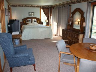 Incline Village house photo - Master/King with love seat in room and table with broadband Internet connection.
