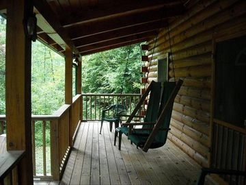 Relax on the porch and swing your heart out..very pretty views. Hear the birds