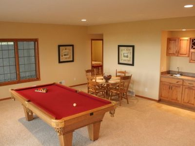 Lower level family/rec room with Billiard Table, wet bar & fridge