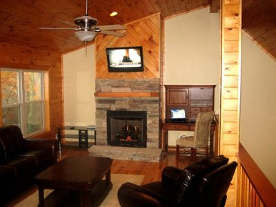 Loft area, features wet bar, computer area, flat screen TV, Fireplace
