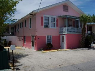 Fort Myers Beach cottage photo - exterior from the street, unit #2 door on left, unit #20 door through gate