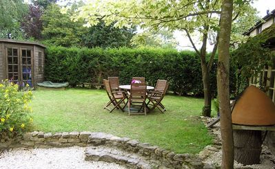 The back garden with parking for 1 car