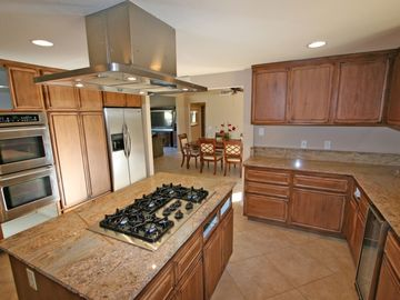 Huge kitchen with all utensils provided. Five burner gas range and twin ovens.