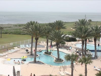 view from the patio overlooking the lazy river pool and bay