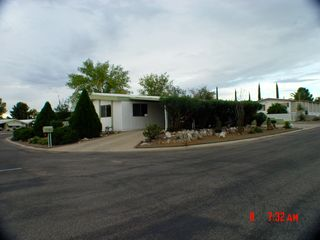 Green Valley mobile home photo - Large corner lot- with covered parking, motion lighting and Secure Lock
