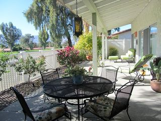 Palm Desert house photo - Patio has dining set that seats 4 with an outdoor chez and love seat.