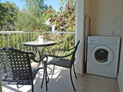Washing machine and balcony
