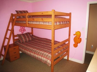 Bedroom #4 with a twin bunk bed overlooks the backyard