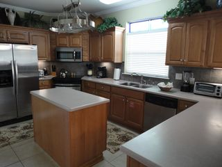 Crystal Beach house photo - Seawatch Kraftmaid Cabinets, S/S Appliances, Wine Cooler & Corian Countertop