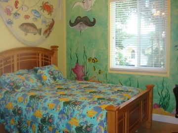Bedroom with hand painted underwater theme
