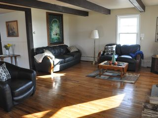 Niagara Falls estate photo - Cozy living room with wood burning stove,,all water views of the Niagara River