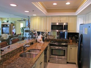 Our kitchen has been remodeled with granite counters, stainless appliances. - Destin condo vacation rental photo