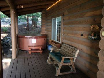 Six person Hot tub has overhang allowing use all year long