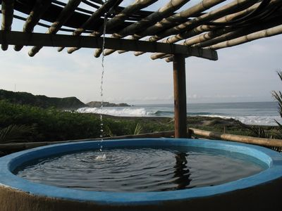 hot tub overlooking the beach and ocean