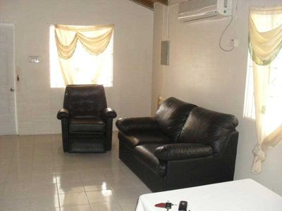 Open plan. Double sofa bed. Reclining chair. Internet. AC/cool tiled flooring.