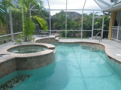 Grand Heated pool with a Hot Spa with patio in a fully covered Lanai. Jump In!