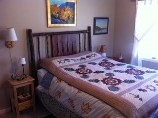 master bedroom, hickory bed, handmade quilt original oil paintings