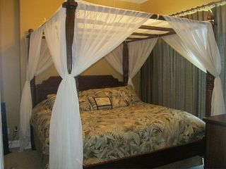 Ocean Villa Resort condo photo - Fabulous 4 Poster King Size Bed With Canopy Bedding Shown