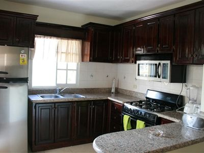 Fully equipped kitchen with door to back terrace