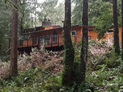 Back view of the house and deck that overlooks the Santiam River.