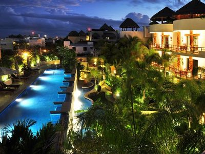 Playa del Carmen condo rental - Porto Playa has 21 units, large sanctuary filled with walkways, tropical plants