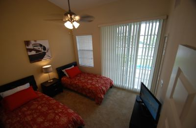 bedroom 2 w. 2 twin beds, LCD-TV, balcony w partially view of waterways & st