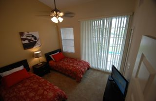 Ruskin townhome photo - bedroom 2 w. 2 twin beds, LCD-TV, balcony w partially view of waterways & st