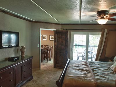 Master bedroom with ceiling fan, DVD player & HDTV