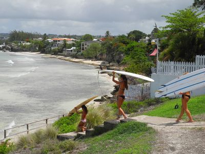 Surfers heading down to beach at Freights Bay