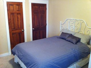 Bedroom #5 with full bed on main level, great for those that can't climb stairs - Colorado Springs house vacation rental photo