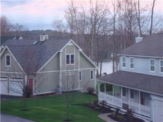 Laconia house photo - Partial lake view from top floor (watch the beautiful sunsets over Gunstock mtn)