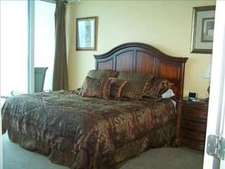 Gulf Shores condo photo - Master bedroom with king size bed, TV, and balcony