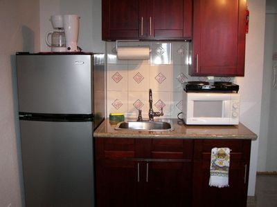 Unit B with full refrigerator and kitchenette.