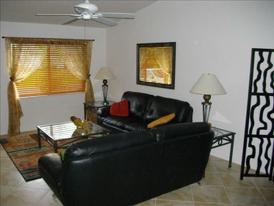 Large Living room . Nice large tile floor that runs throughout for easy upkeep