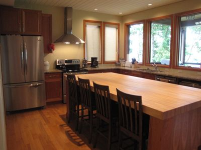 New stainless steel appliances & a gorgeous butcher block island that seats 4.