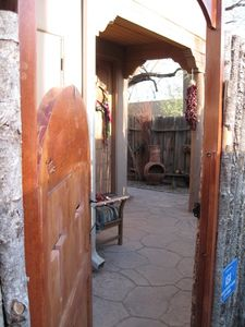 Santa Fe townhome rental - Upon your arrival, view through entry gate to front door.