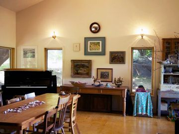 Gracious Dining/Living Room with musical instruments and games for the children