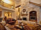An Open Floor Plan with Wonderful Stone and Architectural Details