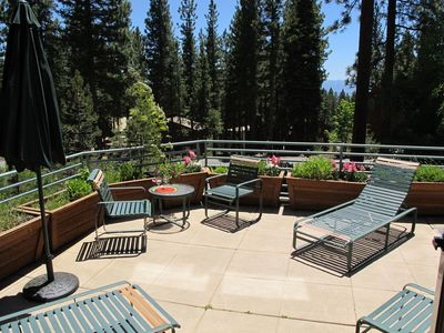 Sunny and spacious front patio with peak views of the lake.
