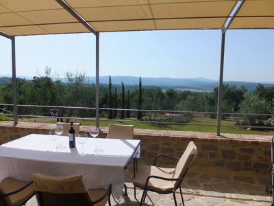 Alfresco dining on terrace looking on olive groves, cypress trees & woodlands.