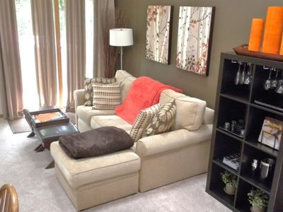 Galena townhome rental - View of living room, the updated sectional faces the fireplace and the 42 in. tv