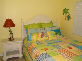 Indian Rocks Beach condo photo - Third bedroom with beach appointed furniture and queen