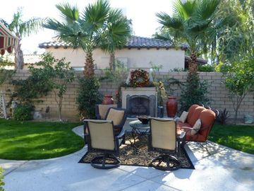 Outdoor gas fireplace and seating area