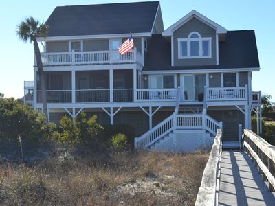 Oceanfront side of house with multiple decks/screen porch and walkway to beach