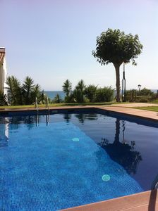 A sea view holiday flat with a large pool near the beach and sea