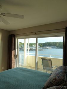 2nd bedroom with direct deck access. Lake view, ceiling fan & private bath.