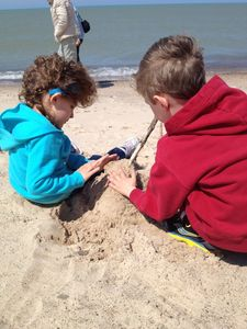Our kids building a sand castle April 2013.